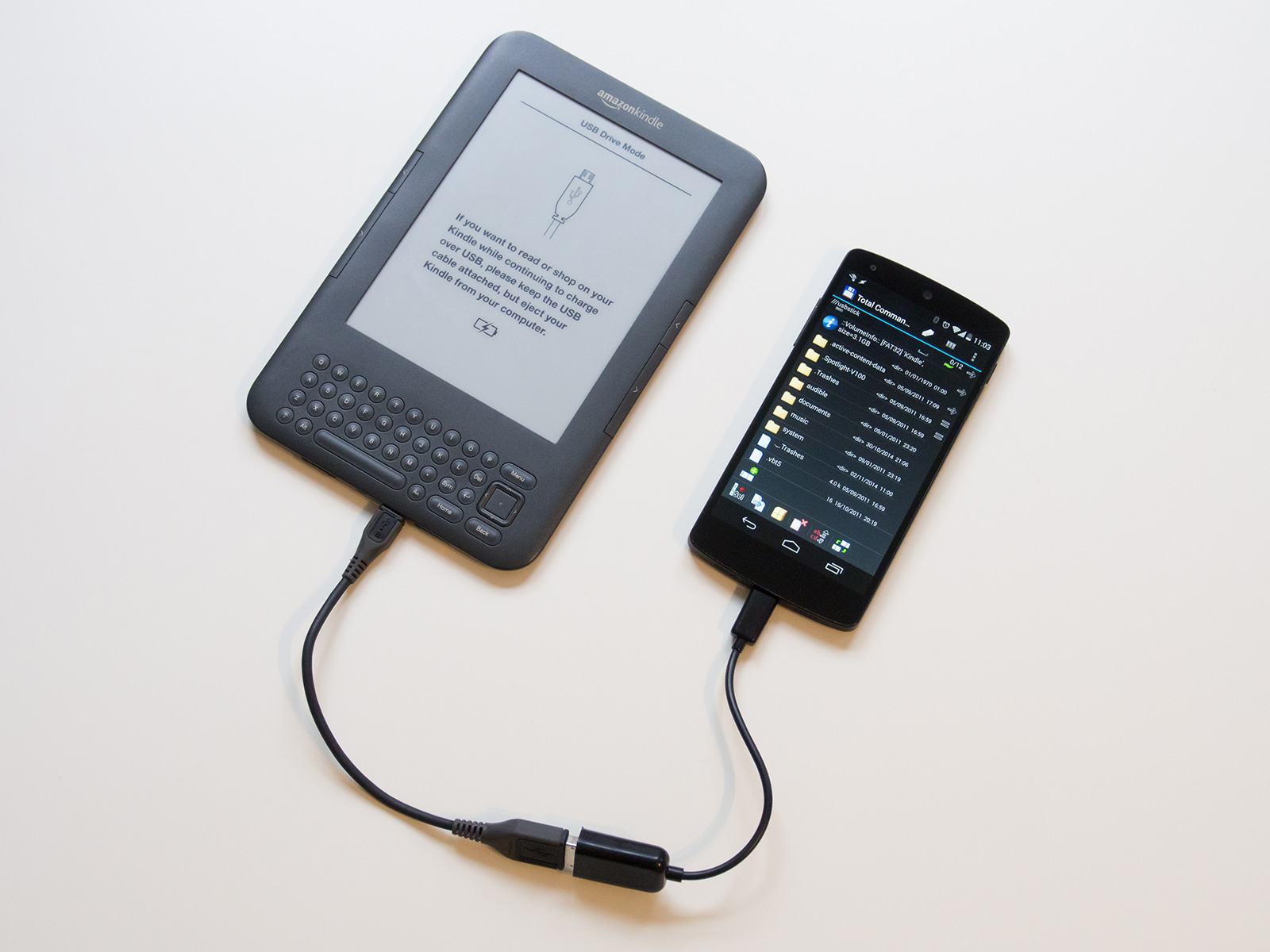Kindle plugged into the Nexus 5 with a USB OTG cable